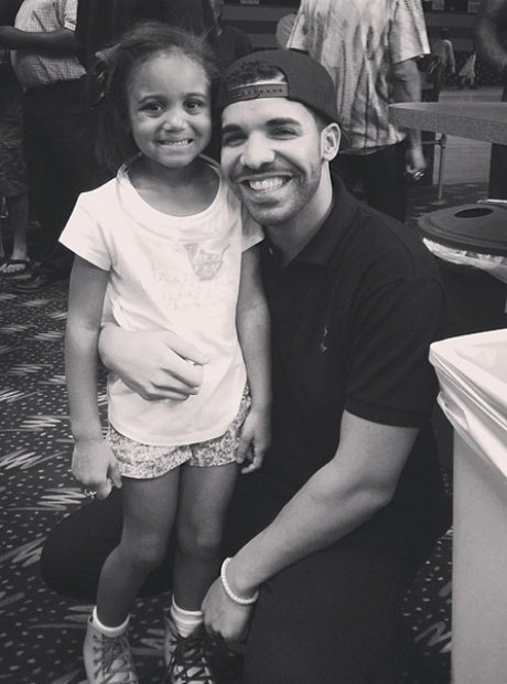 Drake smiling with child