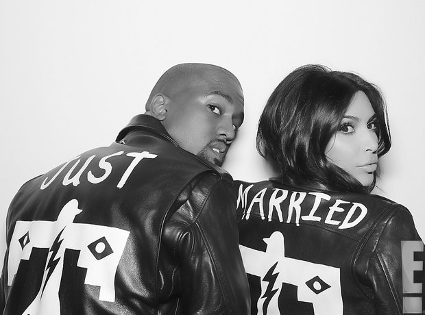 Kim Kardashian and Kanye West wearing leather Just Married jackets.