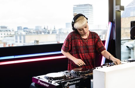 Coco Cole DJ'ing on London roof