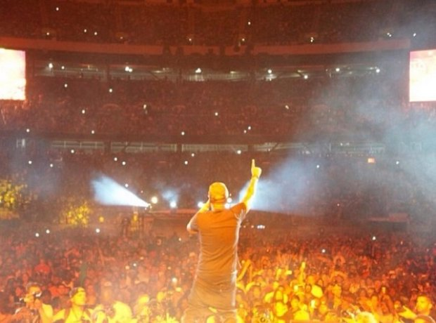 Nas performing on stage at Summer Jam