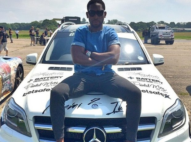 Tinie Tempah At Gumball 2014 sitting on car