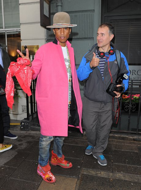 Pharell wearing a pink coat