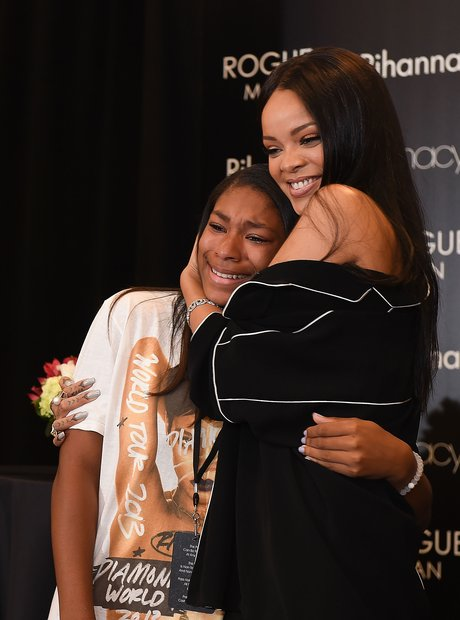 Rihanna hugs a crying fan