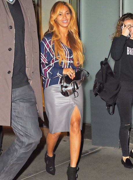Beyonce wears check shirt and leather skirt