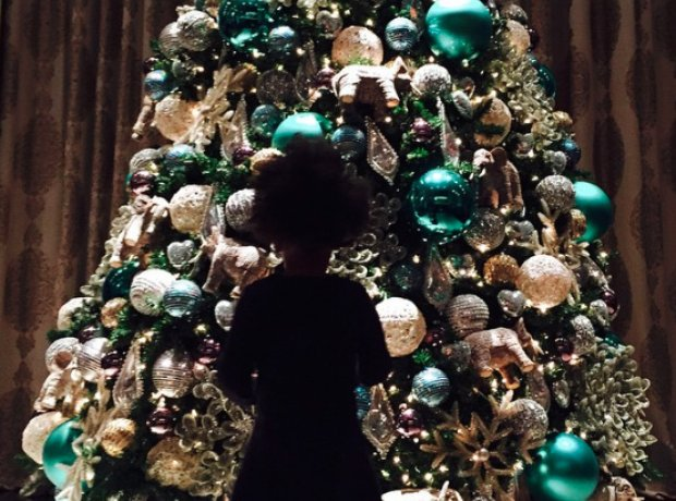 Blue Ivy by the Christmas Tree on Instagram