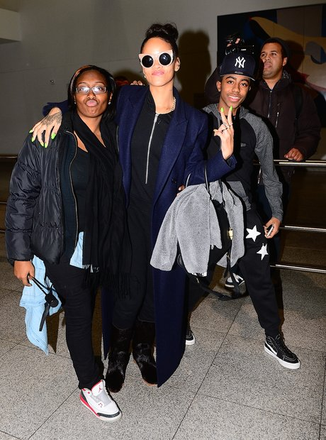Rihanna with a fan at the airport