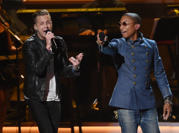 Ryan Tedder and Pharrell on stage