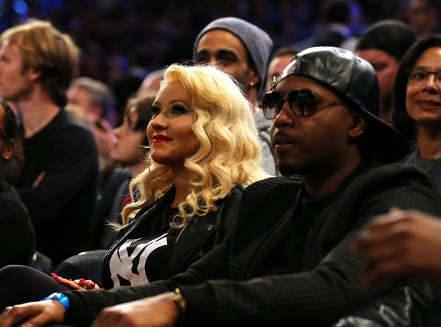 Christina Aguilera and rapper Nas attend the 2015
