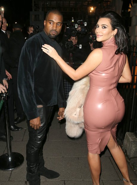 Kim Kardashian wearinga rubber dress with Kanye