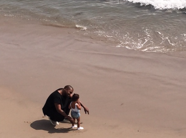 Kanye West with daughter North on the beach