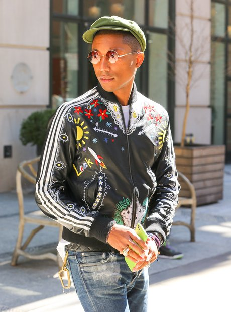 Pharrell wearing a colouful jacket