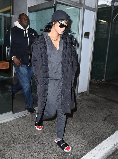 Rihanna wearing slippers