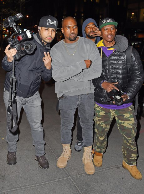 Kanye West and paparazzi escort
