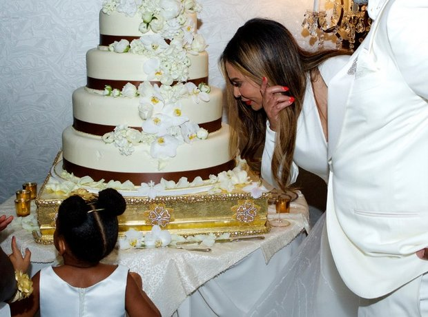 the reception saw blue ivy join tina for the cutting of