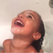 Image 5: North West in the bath laughing