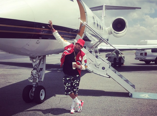 chris brown by a plane