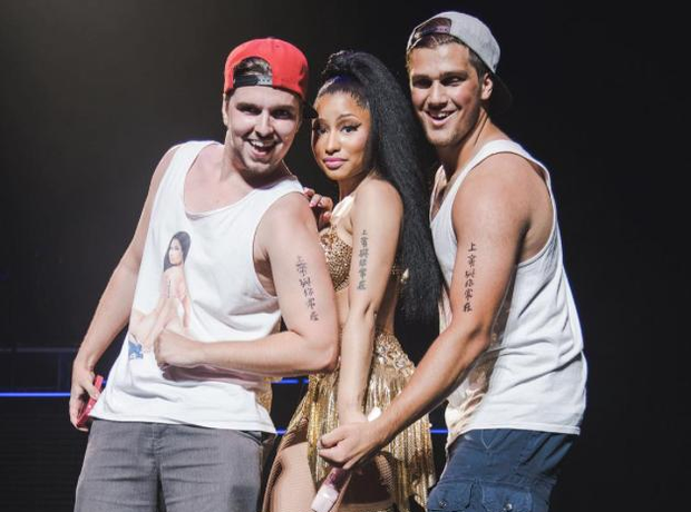 Nicki Minaj poses with fans on stage