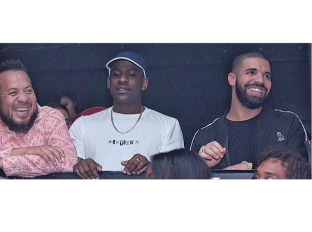 Skepta next to Drake in a club