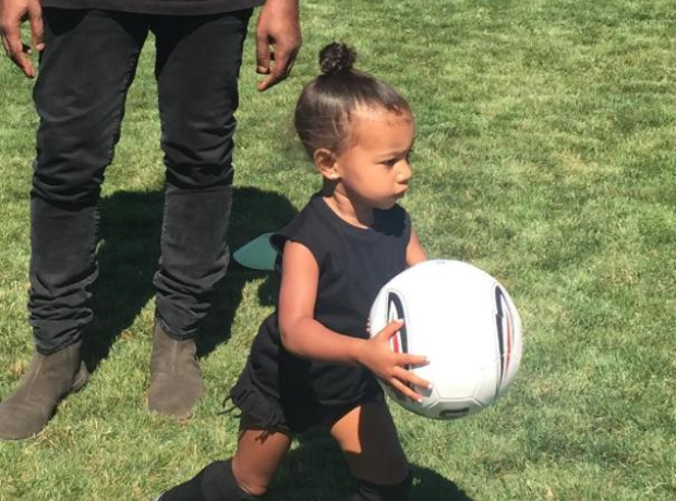 North West running with football