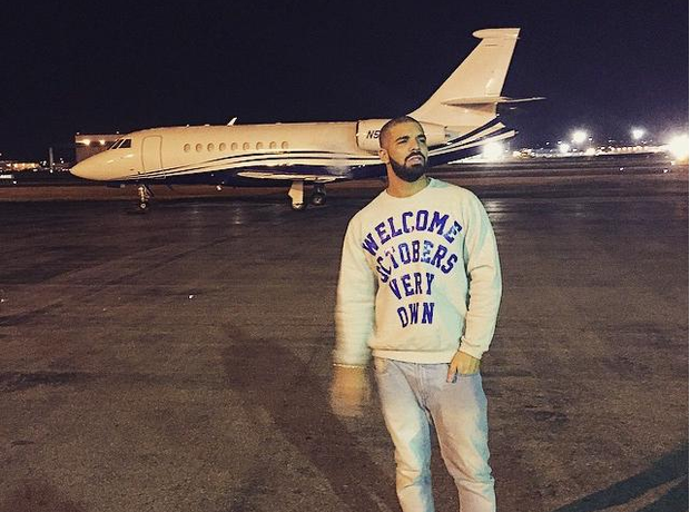 Drake in front of private jet