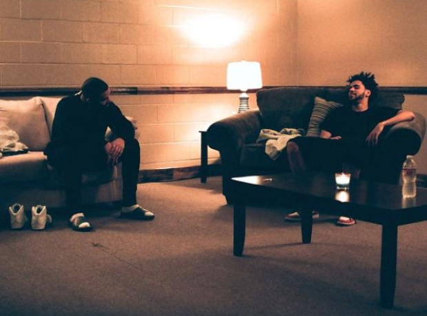Drake and J. Cole sitting on chairs