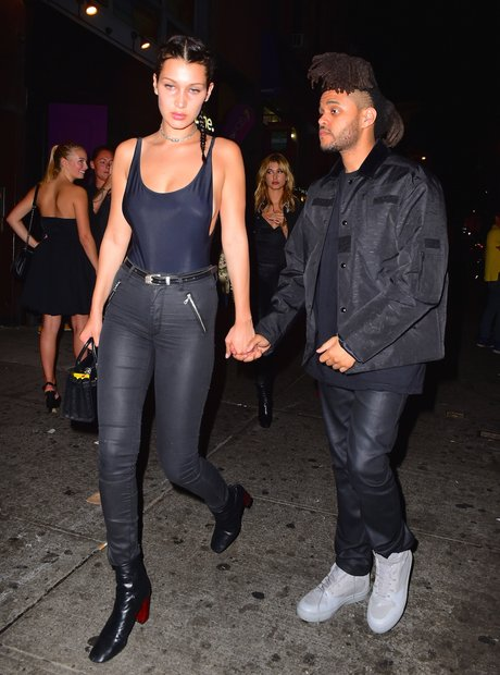 The Weeknd and Bella Hadid holding hands
