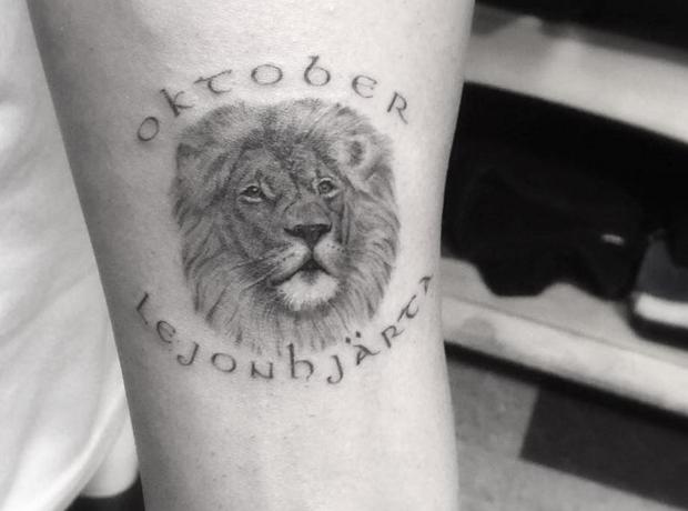 Drake Lionhead tattoo