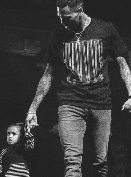 Chris Brown and daughter onstage