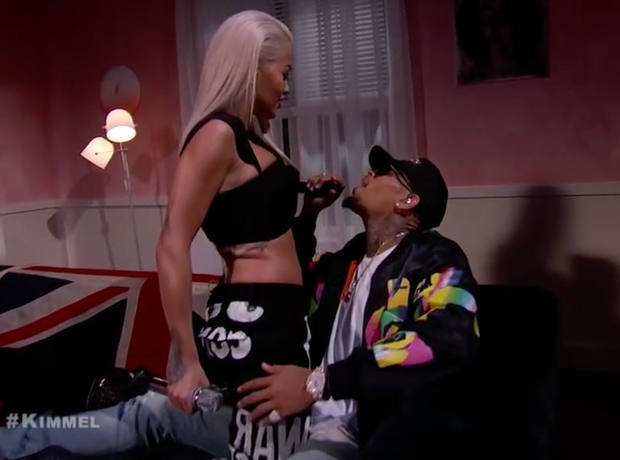 Chris Brown and Rita Ora singing on sofa