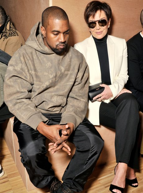 Kanye West looking grumpy at Givenchy