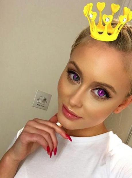 Zara Larsson wearing crown