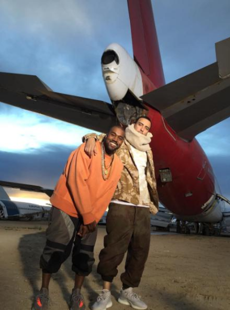 Kanye West and French Montana next to plane
