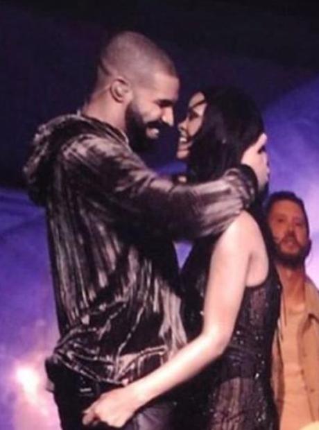 Rihanna and Drake hugging on stage