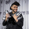 Image 7: The Weeknd holding Juno Awards