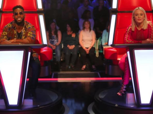 Tinie Tempah and Zara Larsson sat on red chairs
