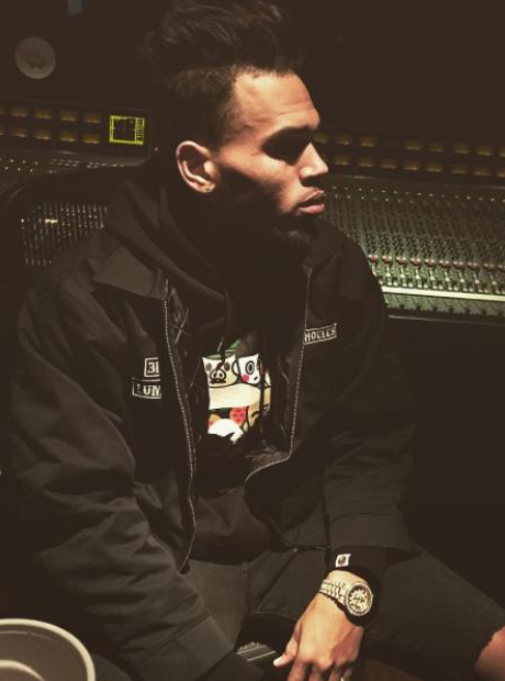 Chris Brown sitting in the studio