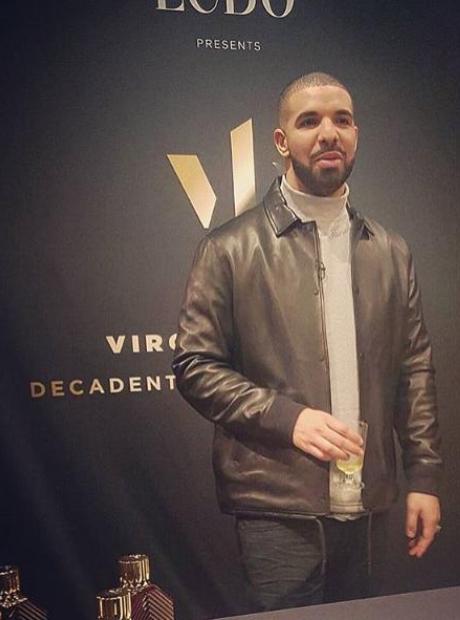 Drake holding drink