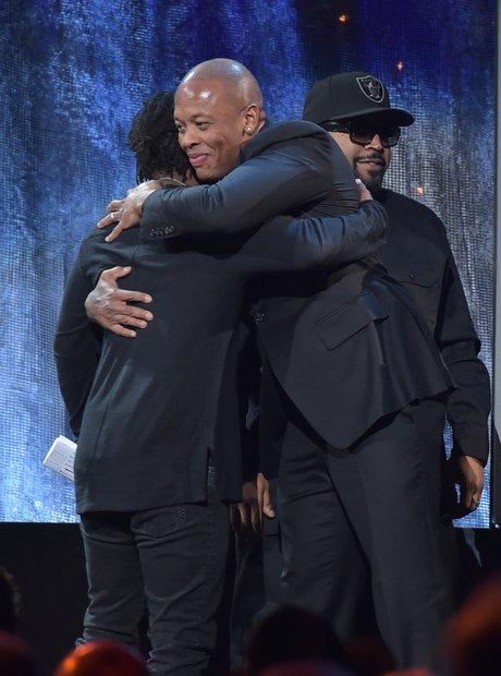 Kendrick Lamar hugging Dr Dre