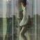 Image 9: Rihanna leaning against window