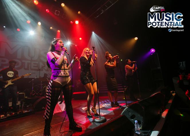 Singers performing on stage