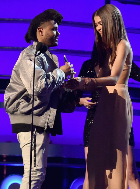 Singer The Weeknd accepts Top R&B Song award for '