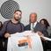 Image 8: Drake holding Nelson Mandela shirt