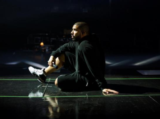 Drake sitting on the floor