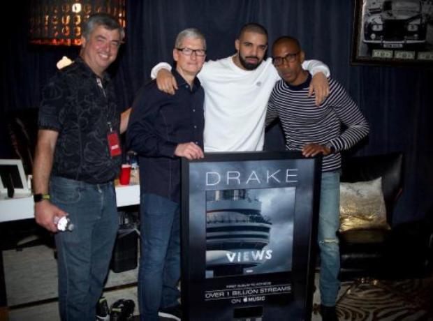 Drake holding plaque
