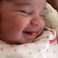 Image 1: Dream Kardashian is pictured smiling
