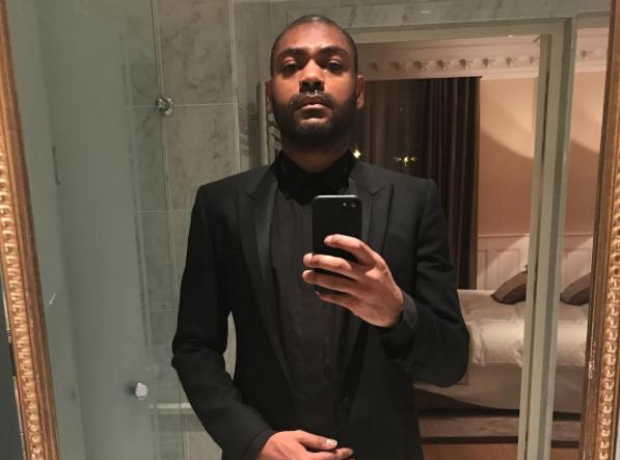 Kano in a suit