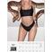 Image 10: kylie jenner holding a snake in 2017 calendar