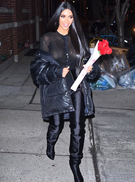 Kim Kardashian holding a bunch of roses