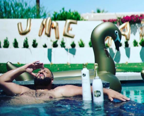 DJ Khaled with an inflatable flamingo