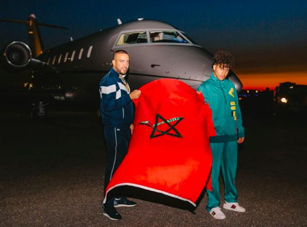 French Montana holding up a Moroccan flag